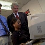 America Online chairman Steve Case, left, and U.S. President Clinton look on as Tiffany