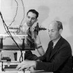 Arnold Beckman and colleague James McCullough at an optical bench, 1934